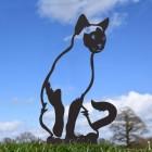 Black Sitting Siamese Cat Silhouette in Situ