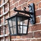 Black Traditional Top Fix Wall Lantern with Ornate Bracket in Situ on a Brick Wall