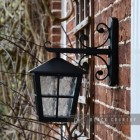 Side View of the Black Traditional Top Fix Wall Lantern with Ornate Bracket