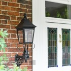 Black Traditional Victorian Wall Light Installed In Front Porch