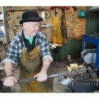 Blacksmith at work creating the Joist Hangers