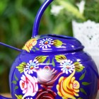 Close-up of the Floral Design on the Watering Can