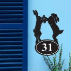 Boxing Hares Iron House Number Sign in Situ on a Blue Wall