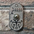 Old Fashioned Door Bell on brick wall