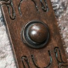 Close up image of Art Nouveau inspired Bell push plate