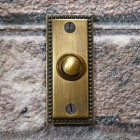 Antique Brass Georgian style bell Push on brick wall