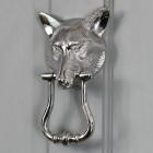 Bright Chrome Fox Head Door Knocker on a Grey Door