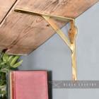 Polished Brass Gallows Bracket Holding Up a Wooden Shelf