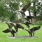 Flying Duck Sculpture in a Bronze Finish