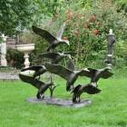 Bronze Finish Flying Duck Sculpture in Situ in the Garden