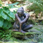 Girl Sitting Sculpture Finished in Bronze