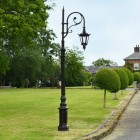 Brown CCast Iron Ornate Swan Neck Lamp Post On Driveway