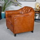 View of the Side of the Brown Leather Traditional Arm Chair