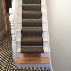 Polished Brass Stair Rods in house, with brown carpet