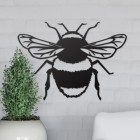 Bumble Bee Wall Art on the Wall Next to Plants