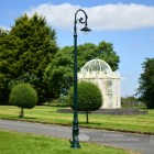 Cast Iron Lamp Post In Antique Green Installed In Garden Setting