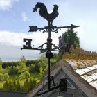Cat iron Rooster Weathervane mounted on house