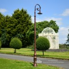 Cast Iron Vintage Lamp Post Column Installed In Garden Setting