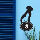 Cat & Dog Iron House Number Sign in Situ on a Blue Wall