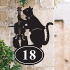 Bespoke Cat & Fiddle Iron House Number Sign on a Garden Wall