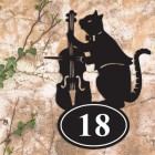 Cat & Fiddle Iron House Number Sign in Situ on a Rustic Wall