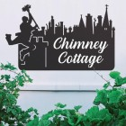 Black Chimney Sweep Iron House Name Sign on a White Wall