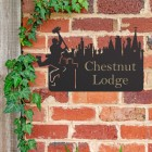 Chimney Sweep Iron House Name Sign in Use on a Brick Wall