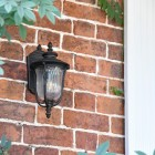 """""""Christleton"""" Bronze Wall Mounted Porch Light in Use by the Front Door of a House"""