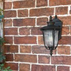 Bronze Wall Mounted Porch Light in Use on the Front of a House