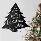 Christmas Tree Steel Wall Art Next to a Christmas Tree