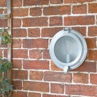 Classic Bulk Head Style Wall Mounted Light in Situ on a Brick Wall
