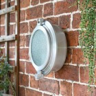 Classic Bulk Head Style Wall Mounted Light on a the Front of a House