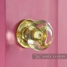 Clear Glass Rim door Knob in Situ on a Pink Door
