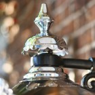 Close-up of the Top Fixing On The Bright Chrome Wall Lantern