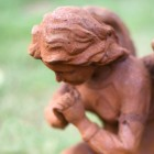 Close of the Detail of the Rustic Angel Statue
