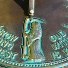 Close up of brass & verdigris old father time