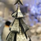Close up of folded metal tree