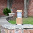 Compact Driveway Wooden Bollard Light in Situ on a Brick Wall