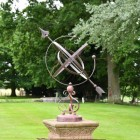 Wrought Iron Armillary in Situ in the Garden on a  Stone Plinth