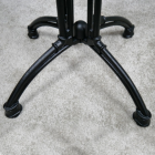 Close-up of the Feet on the cast Iron Bench