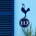 Contemporary Cockerel Iron House Number Sign in Situ on a Blue Wall