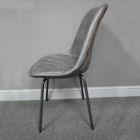 View of the Side of the Grey Leather Dining Chair