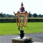 Copper Hexagonal Pillar Light and Lantern in Situ on a brick Pillar