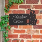 Cricket Player Iron House Name Sign in Use on a Brick Wall