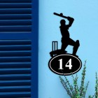 Cricket Player Iron House Number Sign on a Blue Wall