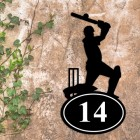 Cricket Player Iron House Number Sign in Situ on a Rustic Wall