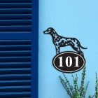 Iron Dalmatian House Number Sign in Situ on a Blue Wall