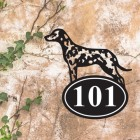 Dalmatian Iron House Number Sign in Situ on a Rustic Wall