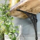 Dark Iron Shelf Bracket Holding Up Wooden Shelf