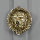 Round Polished Brass Sandringham door knocker on Pastel grey door